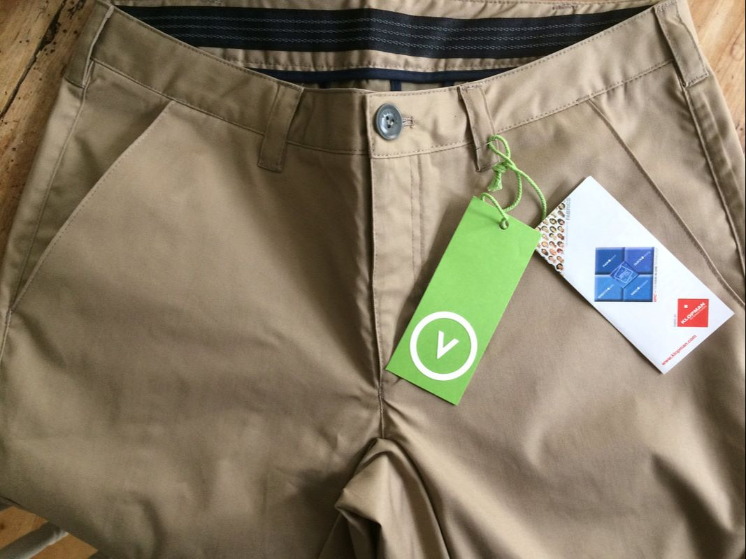 Vulpine cycling rain trouser. Front detail showing button and belt hoops